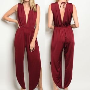 RED WINE JUMPSUIT WITH A DEEP PLUNGE & TIE BACK